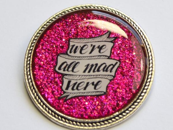 Alice In Wonderland We're All Mad Here Pink Resin Brooch